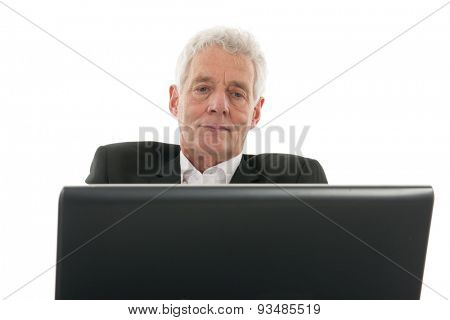 Senior man satisfied with the results at the laptop