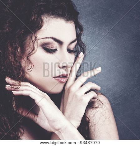 Fashionable female portrait over grungy backgrounds. Vogue vamp style brunette girl.