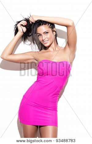 Sexy Brunette Woman In Pink Dress