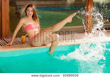 Splashing Woman In Bikini On Pool.