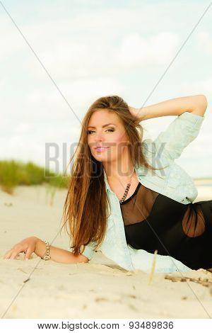 Adorable Girl Lying On Sandy Beach