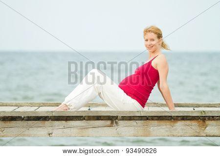 beautiful pregnant woman on a beach