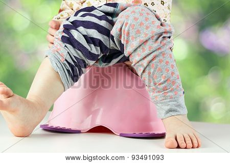 Children's Legs Hanging Down From A Chamber-pot