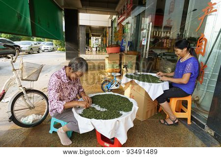 SHENZHEN, CHINA - OCTOBER 03, 2013: Tieguanyin tea sellers. Tieguanyin is a premium variety of Chinese oolong tea originated in the 19th century in Anxi in Fujian province.