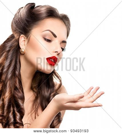 Surprised Retro woman portrait. Beauty vintage girl showing empty copy space on the open hand palm, isolated on white background. Proposing a product. Gestures for advertisement.