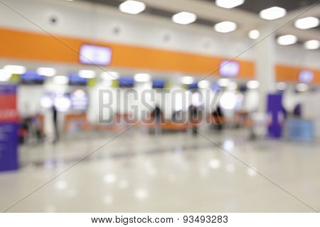 Bokeh of check-in counters in airport - defocused background