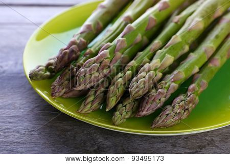 Fresh asparagus on wooden table, closeup