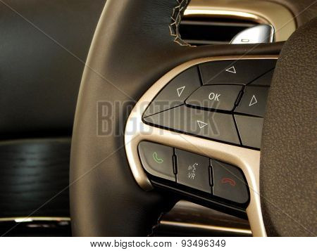 Car parts. Buttons on leather steering wheel