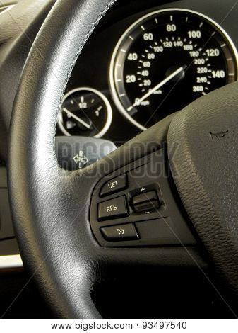 Car interior design. Controls on steering wheel