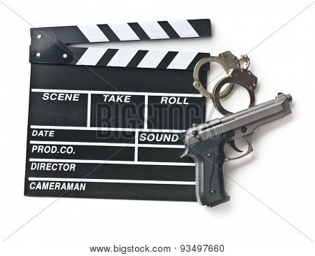 movie clapper and gun with handcuffs on white background