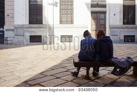 Couple Of Lovers Sitting On A Bench