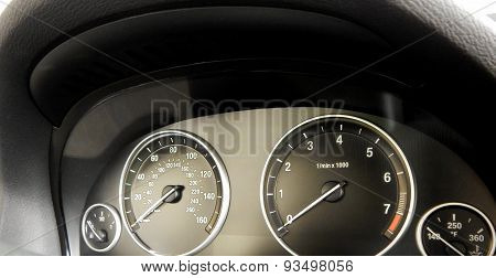 Car interior detailed. Speedometer and tachometer on dashboard