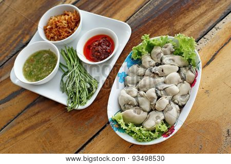 Oysters With Side Dishes On Wooden Desk