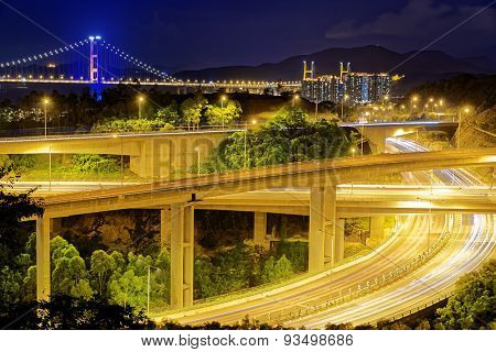 Highway traffic road and tsing ma bridge at night