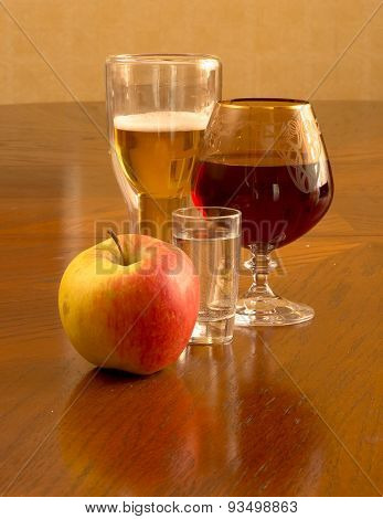 light fresh beer in glasses, on a wooden table