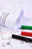 pic of drawing  - Rolls of electrical diagrams and accessories for drawing lying on construction drawings drawings and accessories for the projects engineer jobs - JPG