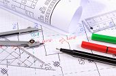 picture of drawing  - Rolls of electrical diagrams and accessories for drawing lying on construction drawings drawings and accessories for the projects engineer jobs - JPG