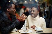 image of san valentine  - Portrait of young beautiful couple in love having coffee in beautiful cafe two young people in cafe enjoying the time spending with each other - JPG