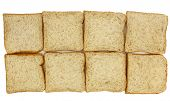 foto of whole-wheat  - Top view of sliced whole wheat breads on white background - JPG