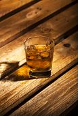 foto of scotch  - Glass of scotch on wooden vintage background with copyspace - JPG