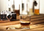 picture of scotch  - Glass of scotch on wooden vintage background with copyspace - JPG