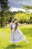 image of polite girl  - Lovely girl playing in a wonderland fairytale - JPG