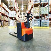 stock photo of pallet  - Manual forklift pallet stacker truck equipment at warehouse - JPG