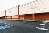 stock photo of department store  - Angled shot of an out of business food store - JPG