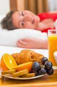 foto of bed breakfast  - cheerful awakened the girl and breakfast in bed