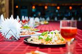 image of banquet  - Served banquet table with glasses and salads - JPG