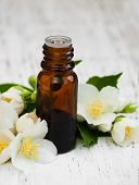 image of essential oil  - essential oil with jasmine flower on a wooden background - JPG