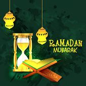image of sand timer  - Islamic religious book Quran Shareef with shiny sand timer and golden traditional lanterns on grungy green background for Islamic holy month of prayers - JPG