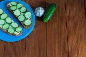 picture of cucumbers  - Freshly sandwich with sliced cucumbers and garlic with cucumber in rural or rustic kitchen at vintage wood table from above - JPG