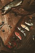 image of fishing bobber  - Fishing tools and fresh pike on a wooden table - JPG
