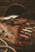 foto of fishing bobber  - Fishing tools and fresh pike on a wooden table - JPG