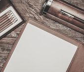 foto of leather tool  - Luxurious writing tools on a wooden table  - JPG