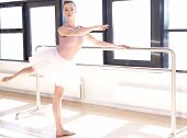 pic of ballet barre  - Young Graceful Ballerina Warming Up and Doing Barre Exercises in Studio - JPG