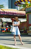 picture of amusement  - Beautiful young girl at the amusement park - JPG