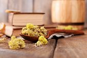 foto of roughage  - Old books with dry flowers on table close up - JPG