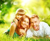 stock photo of mother baby nature  - Happy joyful young family father - JPG