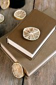 image of roughage  - Old books with dry lemon on wooden background - JPG