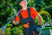 foto of shoulders  - Satisfied Professional Gardener with Shoulder Lawn Mower - JPG