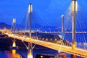 stock photo of hong kong bridge  - highway bridge at night with traces of light traffic - JPG