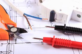 image of electrical engineering  - Cables of multimeter metal pliers electric wire and fuse on construction drawings electrical drawings and tools for engineer jobs - JPG