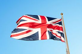 foto of british culture  - British flag or union jack flying on a flag pole against a blue sky - JPG