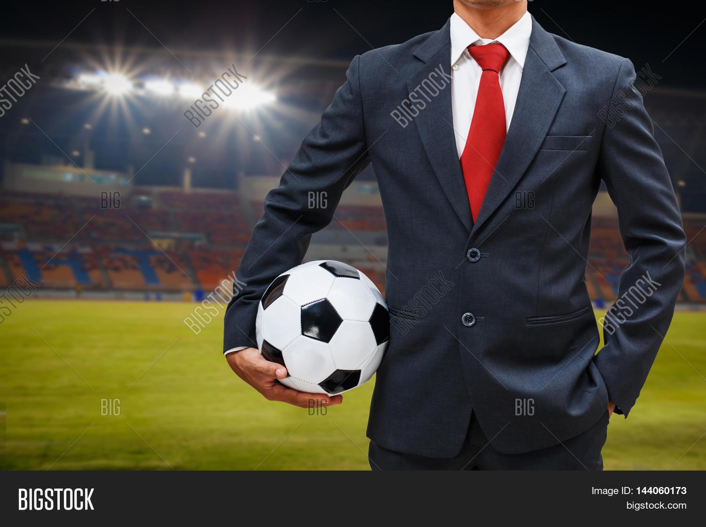 soccer manager in the stadium holding soccer ball Stock ... Soccer Manager