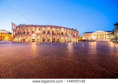 Night view on illuminated Arena on Bra square in Verona city