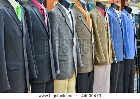 Range of suits on Shop Mannequins at front of shop