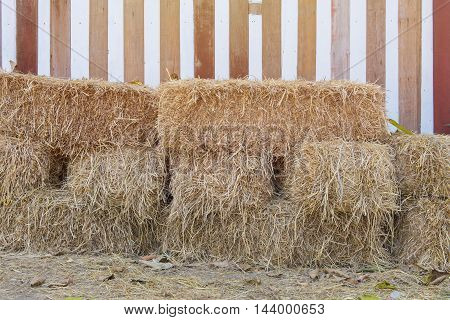 stack of straw or hay bales in a rural landscape.
