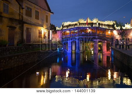 HOI AN, VIETNAM - JANUARY 02, 2016:  View of the old Japanese bridge in night illumination. Historical landmark of the city Hoi An, Vietnam